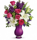 Chic and modern - just like mom! Make her Mother's Day sparkle with this shining celebration of your love. Gorgeous pink roses, white lilies and lavender statice look oh-so-lovely in this unique vase, resplendent in a metallic purple glaze with a band of sparkling rhinestones at its base. So glam!  This delightful bouquet features dark pink roses, white asiatic lilies, lavender stock, green button spray chrysanthemums, lavender sinuata statice, sword fern and huckleberry. Delivered in a Sparkle And Shine vase. Serving all of Toronto.