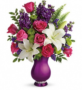 Chic and modern - just like mom! Make her Mother's Day sparkle with this shining celebration of your love. Gorgeous pink roses, white lilies and lavender statice look oh-so-lovely in this unique vase, resplendent in a metallic purple glaze with a band of sparkling rhinestones at its base. So glam!  This delightful bouquet features dark pink roses, white asiatic lilies, lavender stock, green button spray chrysanthemums, lavender sinuata statice, sword fern and huckleberry. Delivered in a Sparkle And Shine vase. Toronto florist. North York flower shop.