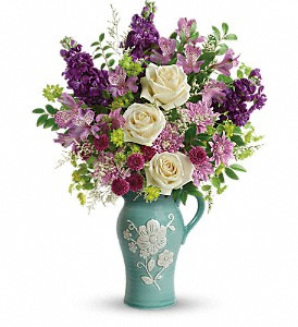 Artisanal beauty and charm! Make Mother's Day one to remember with this 2-in-1 gift for mom - a stunning, softly hued bouquet of roses, alstroemeria and stock presented in a food-safe stoneware pitcher. Featuring hand-painted and embossed details, the artisanal keepsake is both pretty and practical!  Crème roses, lavender alstroemeria, purple stock, purple button spray chrysanthemums, lavender cushion spray chrysanthemums, and white limonium are accented with bupleurum and huckleberry. Delivered in an Artisanal Beauty pitcher.
