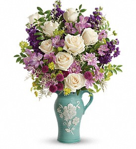 Artisanal beauty and charm! Make Mother's Day one to remember with this 2-in-1 gift for mom - a stunning, softly hued bouquet of roses, alstroemeria and stock presented in a food-safe stoneware pitcher. Featuring hand-painted and embossed details, the artisanal keepsake is both pretty and practical!  Crème roses, lavender alstroemeria, purple stock, purple button spray chrysanthemums, lavender cushion spray chrysanthemums, and white limonium are accented with bupleurum and huckleberry. Delivered in an Artisanal Beauty pitcher. Toronto and all of the GTA.