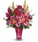 When only the best will do for Mother's Day, surprise her with this incredible gift! Large and lush, this bouquet of hot pink roses, pink stargazer lilies and lavender mums is fragrant, feminine and fabulous. What an unforgettable treat when hand-delivered in this exquisite blown glass vase!  This elegant bouquet features hot pink roses, pink stargazer lilies, burgundy stock, lavender cushion spray chrysanthemums, pink snapdragons, spiral eucalyptus, and lemon leaf. Delivered in a Bold Elegance vase. Toronto delivery for Mother's Day.