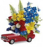 Toronto Father's Day delivery in Toronto by a long time florist. Vroom, vroom! Get his motor running this Father's Day with a freewheelin' gift he'll never forget - a bold bouquet of alstroemeria, carnations and mums, in a '65 Ford Mustang convertible keepsake. Hand-painted in classic poppy red, this ceramic collectible is one-of-a-kind, just like Dad.