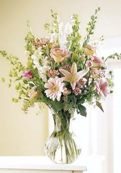 Make a lasting impression with this beautiful bouquet of roses, lilies, daisies and more. Soft delicate pink and cream.