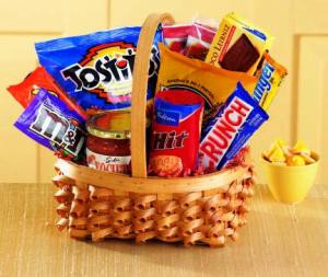 No matter the occasion, they'll appreciate our Big Munch basket. An oval braided basket holds sweet and salty munchies - Tostitos and salsa, pretzel sticks, chocolate cookies, candy bars and popcorn.  products may vary.