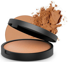 A Pure Mineral Bronzer Naturally Baked into Solid Form on a Terracotta Tile in Italy