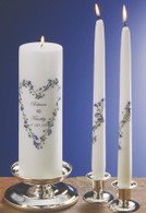 Real forget me not flowers are hand placed in a heart design on this unity candle.