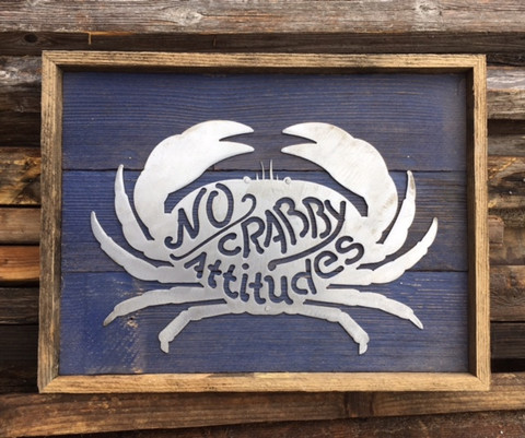 No Crabby Attitudes brushed metal sign mounted on reclaimed stained wood.