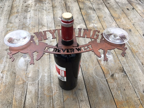 Wyoming Wine Topper mounted over wine bottle with balancing wine glasses.