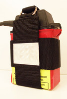 Small heavy duty holder for mining battery attaches to belt loop with heavy duty Pebble Webbing.
