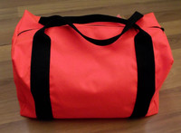 Industrial strength small duffle bag has heavy duty straps that wrap around the bag for added strength.