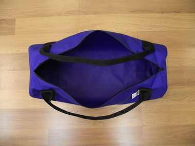 Our Heavy Duty Nylon Duffle Bag comes in Red, Royal Blue (shown), Orange and Black.