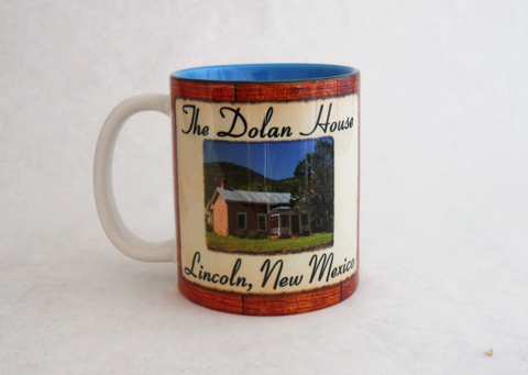 Heavy ceramic coffee mug with a picture of The Dolan House.  Take a  Coffee Mug home to remind you that you ate or stayed in this Historic home.