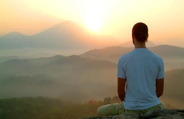 man-watching-sunset-and-meditating-.jpg