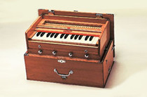 Beautiful Bina Harmonium - 23B - Deluxe Model with 2.5 Octaves made with dried Indian tun wood, this lovely model comes in teak colored wood.