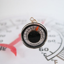 Thermometer necklace is a miniature version of the familiar wall thermometers.