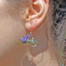 Wear flowers in your ear with mini glass vase earrings.