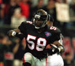 JESSIE TUGGLE Atlanta Falcons 1994 Home Throwback NFL Football Jersey - ACTION