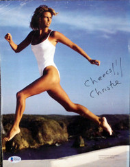 "Christie Brinkley Autographed 10x13 Magazine Page Photo ""Cheers!!"" Beckett BAS #H10147"