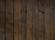 Dark rustic wood floor.Large planks