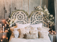 pretty boho headboard with candels