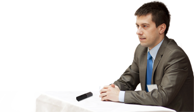 Conference speaker using Start-Stop PUMA wireless mic at table.