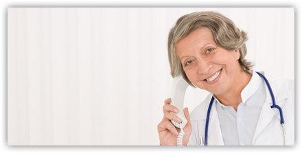Older female doctor using phone to call HTH Engineering for support and training on Dragon Medical Practice Edition 4.
