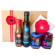 A hamper featuring Tall Poppy Gourmet's most popular products and pure linen signature tea towel