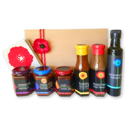 A hamper featuring Tall Poppy Gourmet's most popular products and pure linen signature tea towe