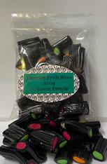 Liquorice Fruit Bites Bag. 1 x 220g Bag. Soft Fruit flavoured center with and black liquorice around the outside.