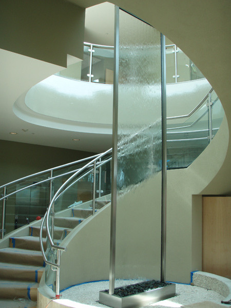 Tall glass custom indoor water feature.
