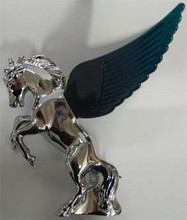 Chrome Fighting Stallion Hood Ornament with Green Illuminated Wings.