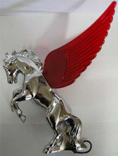 Chrome Fighting Stallion Hood Ornament with Red Illuminated Wings.