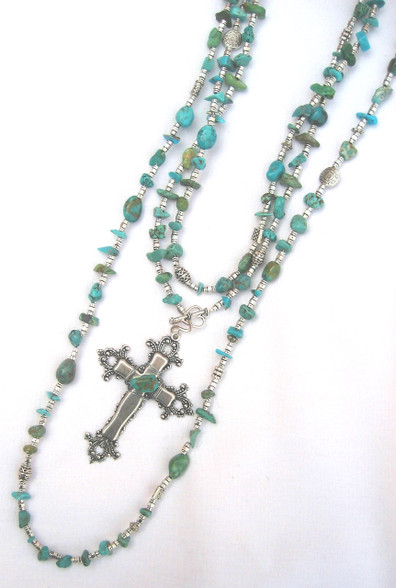 """Each necklace is a mix of Genuine Turquoise in all shapes and sizes. Wear long or short. 36"""" long with detachable cross. Shown here: 1 36"""" neck with cross doubled 1 36"""" mix neck"""