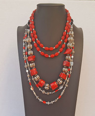 "Red Coral Necklaces . Mix and match these 3 necklaces for many different looks. Priced separately.  All necklaces are adjustable. From the top: Double Strand Red Howlite -Adjustable 18""-24-$72                            : Chunky XL Red Bamboo Coral - $60                            : Red Coral and Mixed Silver Beads- $49 special price for all 3 necklaces as shown- $175"