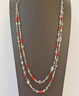 "Red Coral and mixed Antiqued Silver bead  Double Strand Necklace. Black leather tie closure allows you to adjust this from 20"" - 26"""