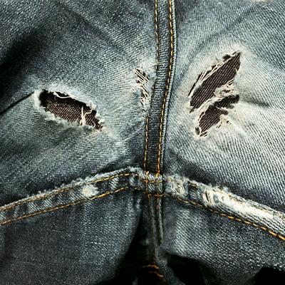 denim fills holes of blow-out denim jeans crotch