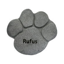 Polymer paw print rock urn designed for outdoor use. Personal engraving included.