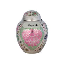 The Silver Rose Urn is meticulously hand-engraved and painted with a lotus flower design, delicately placed inside the shape of a heart. This urn Is brass with a polished nickel plated finish. The top of the urn is threaded for secure closure. The small urn will hold pet remains for pets up to 30 lbs. The large urn will hold pet remains for pets up to 80 lbs. The extra large urn will hold pet remains for pets up to 100 lbs.  Urn necklace is included so you may personalize this urn with your pet's name.