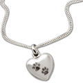 "Keep the memories close with a beautiful sterling heart shaped pendant that holds a small portion of cremated remains.  This pendant is engraved with two paw prints.  Includes an 18"" high quality chain."
