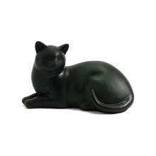 "Figurine Urn made of resin.  Dimensions 5.2"" H x 8.5"" W x 4.6"" D.  For pets up to 15 lbs. (25 cu. inch capacity). Personalization is available on a 2"" x 1"" metal plate on the underside of the urn."