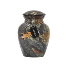 This attractive resin camouflage urn has a threaded lid for secure closure.  The keepsake size holds a small portion of cremated remains or a pet up to 2 lbs.  The small urn has a capacity of 40 cubic inches and holds up to a 30 lb pet.  The medium urn has a capacity of 120 cubic inches and holds up to a 120 lb. pet.  The large urn has a capacity of 200 cubic inches and holds up to a 200 lb. pet.  A dog tag necklace with ball chain uniquely personalizes this urn and is included in your purchase at no additional charge.  Dog tag necklace NOT available for the keepsake size urn.