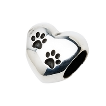 A beautiful sterling silver heart charm with two paw prints to honor your beloved pet in a unique way.  Fits any 2.8 mm bracelet, including the PR109B NozyPaws Bracelet.  Does not hold cremated remains.