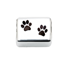 A beautiful sterling silver rectangle charm with paw prints to honor your beloved pet in a unique way.  Fits any 2.8 mm bracelet, including the PR109B NozyPaws Bracelet.  Does not hold cremated remains.