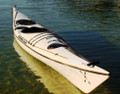 A white Mirage sea kayak - stocked item also has carbon fibre rim & rudder
