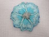Aqua Blue Pansy Silver Embroidered Iron On Patch .75 In