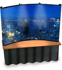 8' tabletop pop up display with background of city during night time.