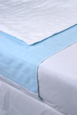 Jaycare Sleep Dry on made up bed.