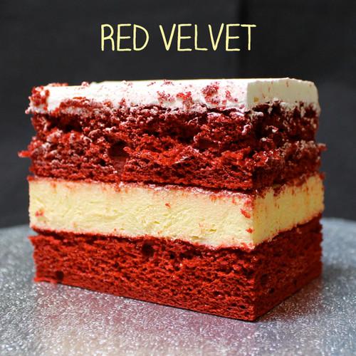Cream cheese-less... Southern Red Velvet cake + French vanilla custard + Lisa's signature Italian whipped cream frosting.