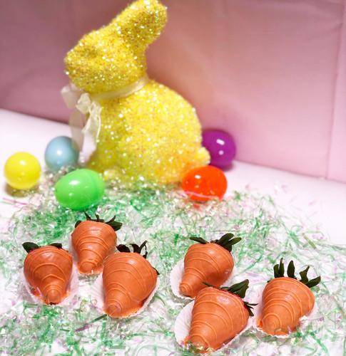 Premium strawberries dipped in orange colored white chocolate ganache with edible glitter.