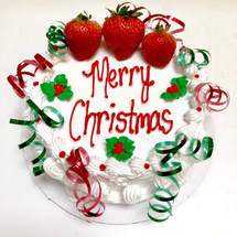 Cathy's seasonal holiday decor features fresh strawberries, hand-piped holly berries and ribbons or a bow (if you would like).